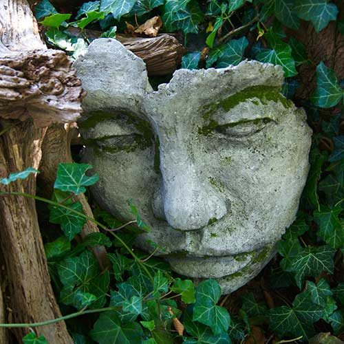 concrete face sculpture