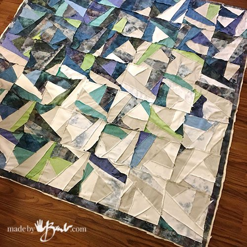 large image of layered quilt piece ready for outside edge sewing