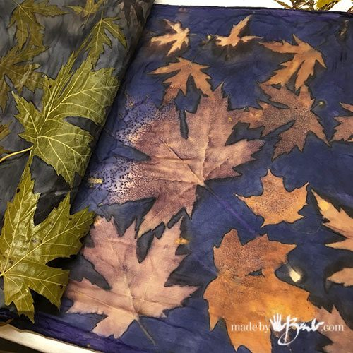 blue background with golden leaf prints