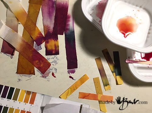 litmus paper strips with many tones of purple from logwood dye