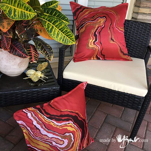 2 geode design cushions on porch furniture