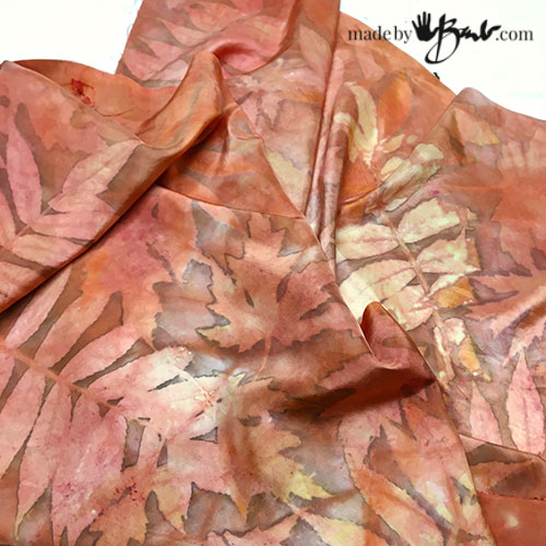 reddish silk scarf with many tones