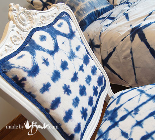 antique chair covered in shibori dyed fabric close