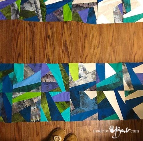 blue tone quilt squares on floor