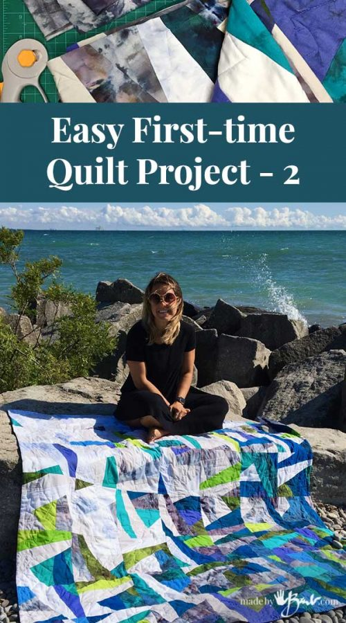 girl sitting on rock at beach with blue tone quilt