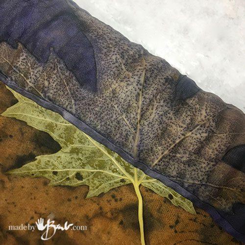 close-up detail of maple leaf print through silk