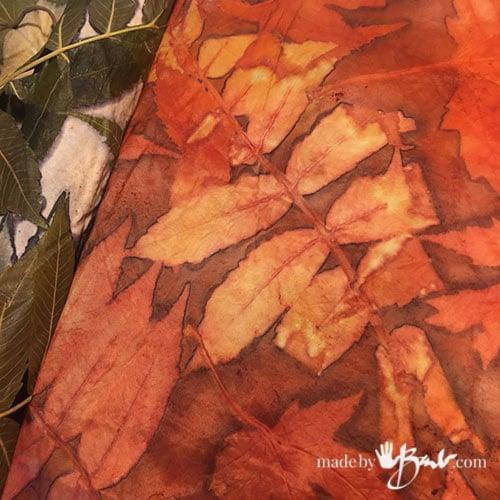 Reddish eco print showing sumac leaf details