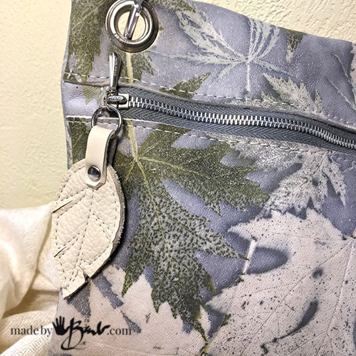 beautiful eco printed leather purse with leather leaf