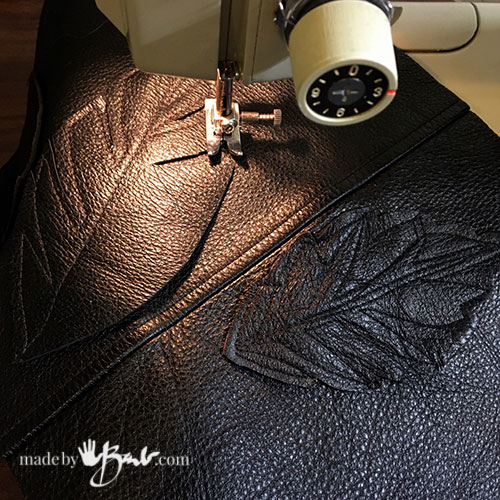 process of sewing leather with machine