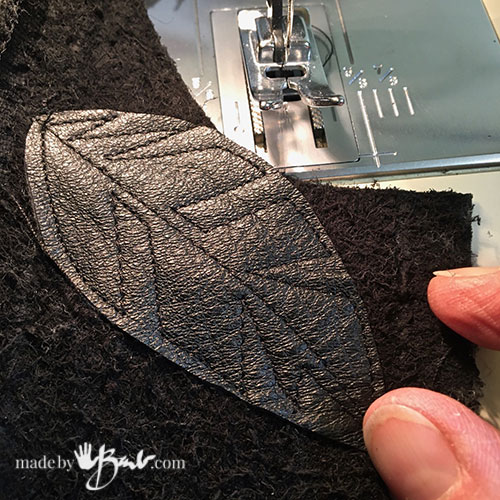 sewn leaf design on leather shape