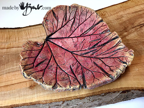 beautiful red toned curved leaf on live edge wood