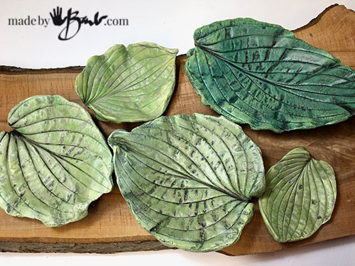 5 leaf cast bowls painted in various greens